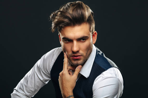 portrait od handsome man in studio on dark background - hairstyle stock photos and pictures