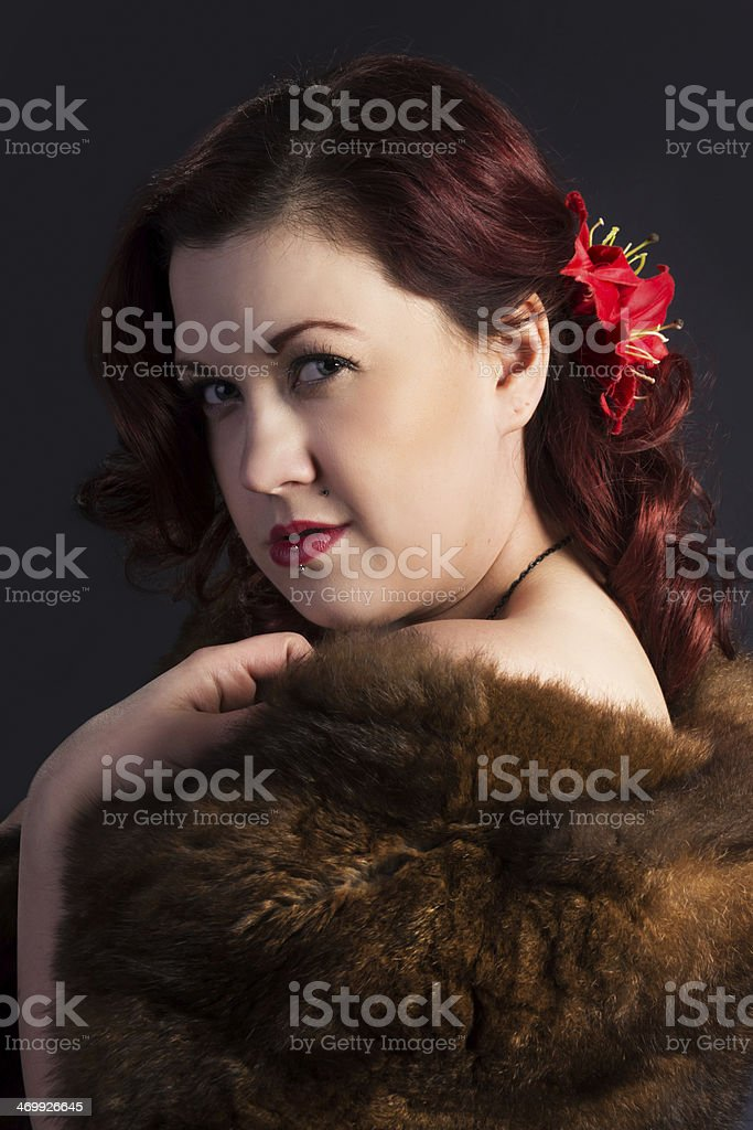 Portrait of 1940's movie glamour styled woman wrapped in fur royalty-free stock photo