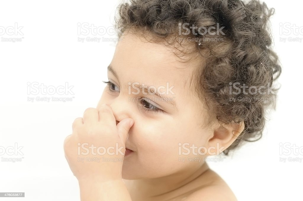 PEOPLE: Portrait of 2 Years Old Girl Holding Her Nose. royalty-free stock photo