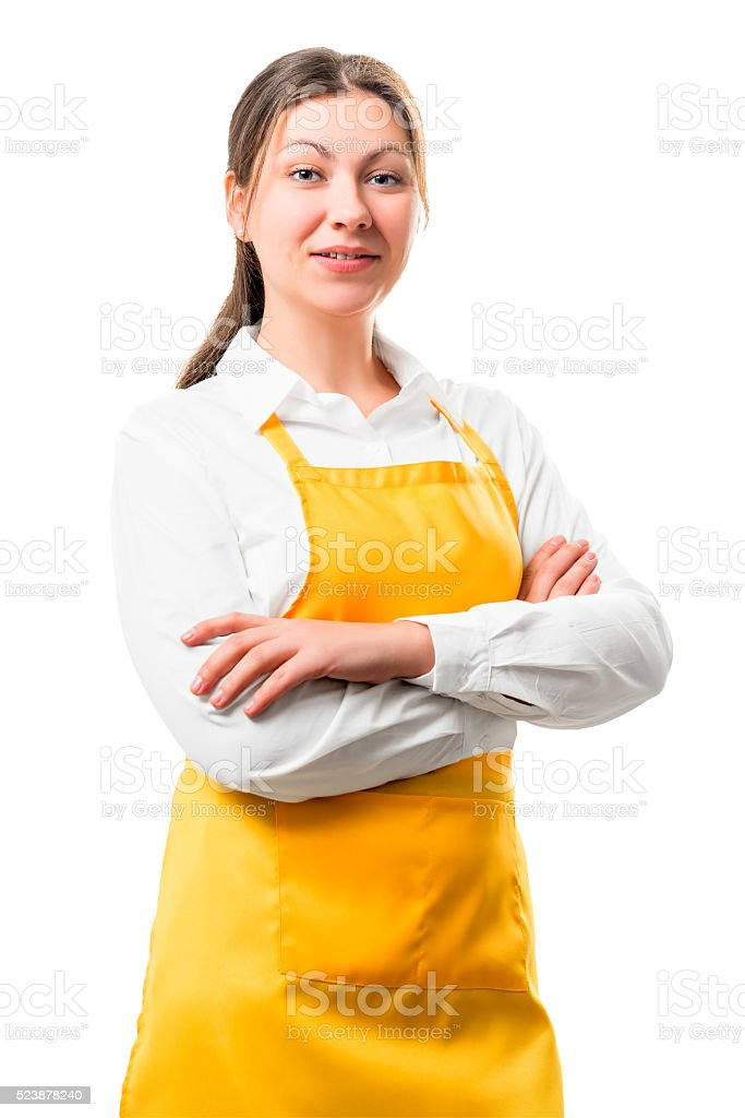 portrait of 30-year-old housewife in yellow apron isolation stock photo