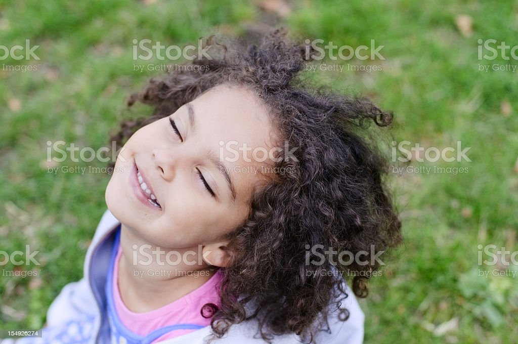 Portrait of  4 Years old Little Girl looking Up, Outdoor royalty-free stock photo