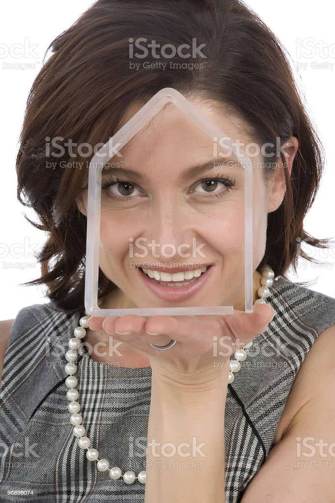 portrait of 40s woman with a transparent house royalty-free stock photo