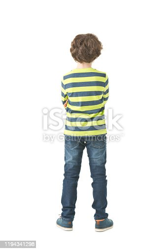 Isolated picture of 8 years old boy. Back view. Full body isolated.