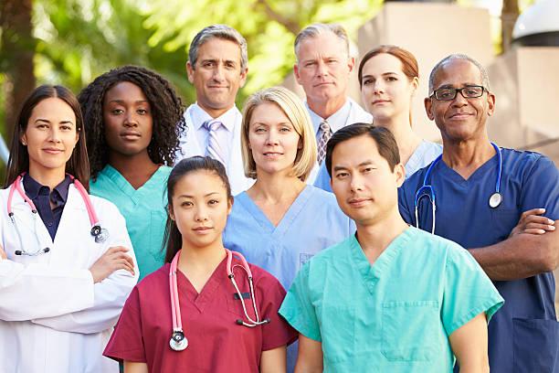 Portrait of 9 medical professionals stock photo