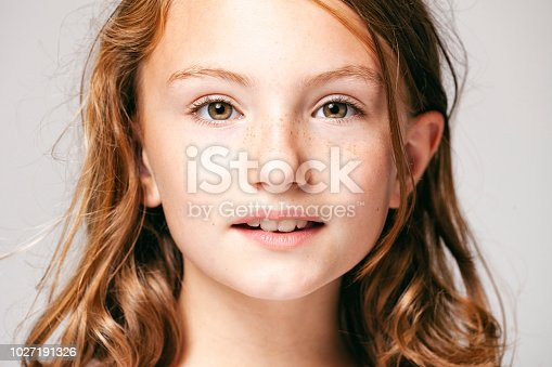 istock Portrait of a 10 years old pretty girl  -  Child Teenager Face Hair Beauty Fun Eyes Freckles 1027191326
