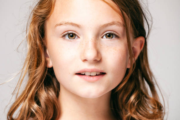 Portrait of a 10 years old pretty girl  -  Child Teenager Face Hair Beauty Fun Eyes Freckles Headshot of a 10 years old cute girl. 12 13 years stock pictures, royalty-free photos & images