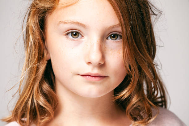 Portrait of a 10 years old pretty girl  -  Child Teenager Face Hair Beauty Fun Eyes Freckles stock photo