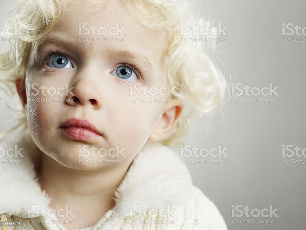 Portrait of a 3 year old girl looking up. royalty-free stock photo