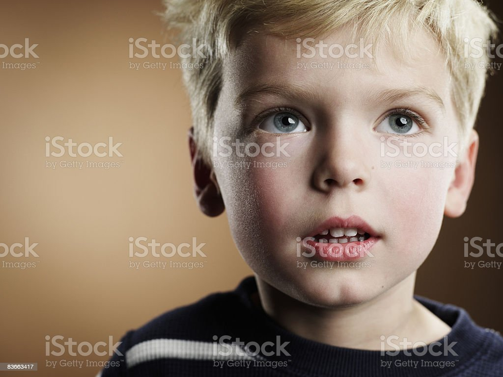 Portrait of a 4 year old boy looking up. royalty-free stock photo