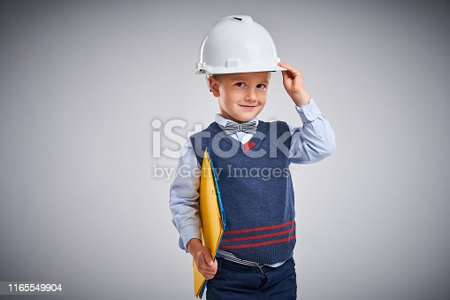 istock Portrait of a 4 year old boy posing over white 1165549904