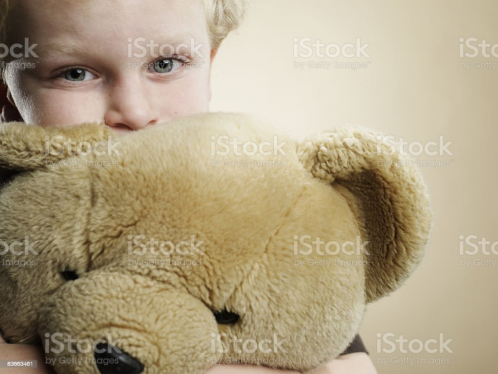 Portrait of a 6 year old boy hugging teddy bear royalty-free stock photo