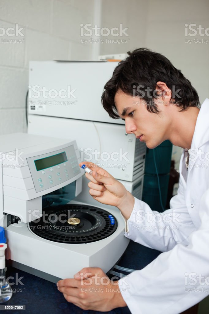 Portrait of a a student using a centrifuge stock photo