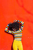 Portrait of a Afro woman on colorful background