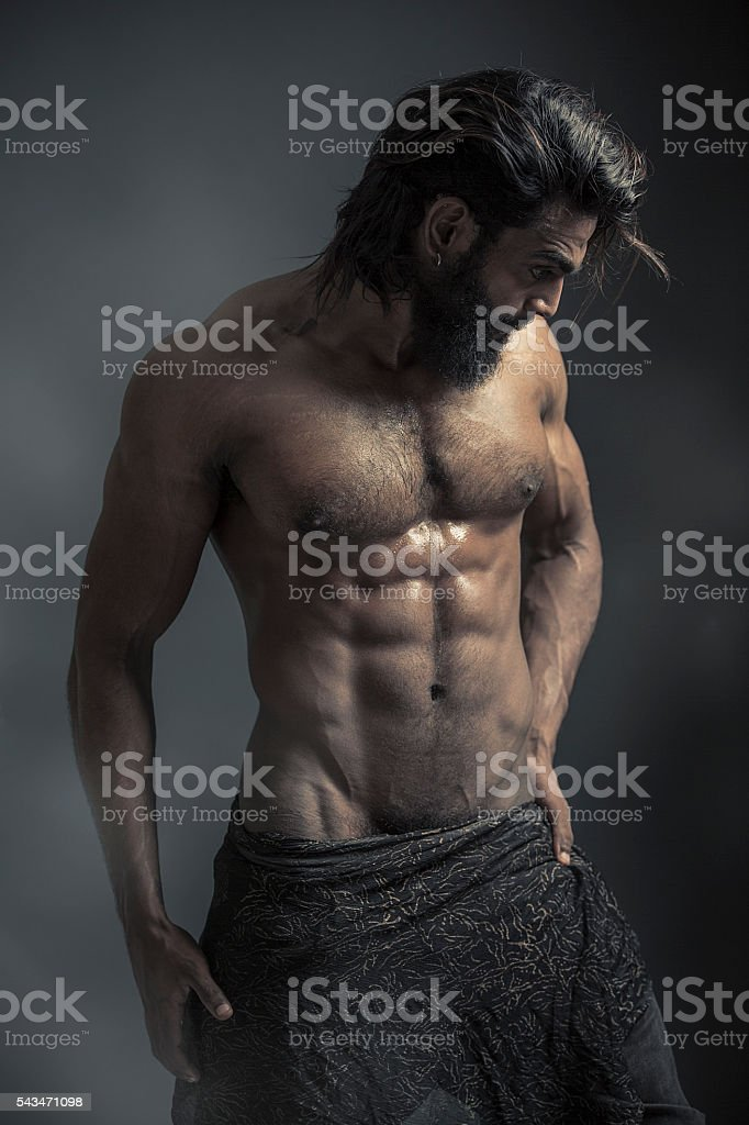 Portrait of a athleltic muscular bearded man stock photo