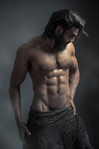portrait of a athleltic muscular bearded man - desnudos fotografías e imágenes de stock