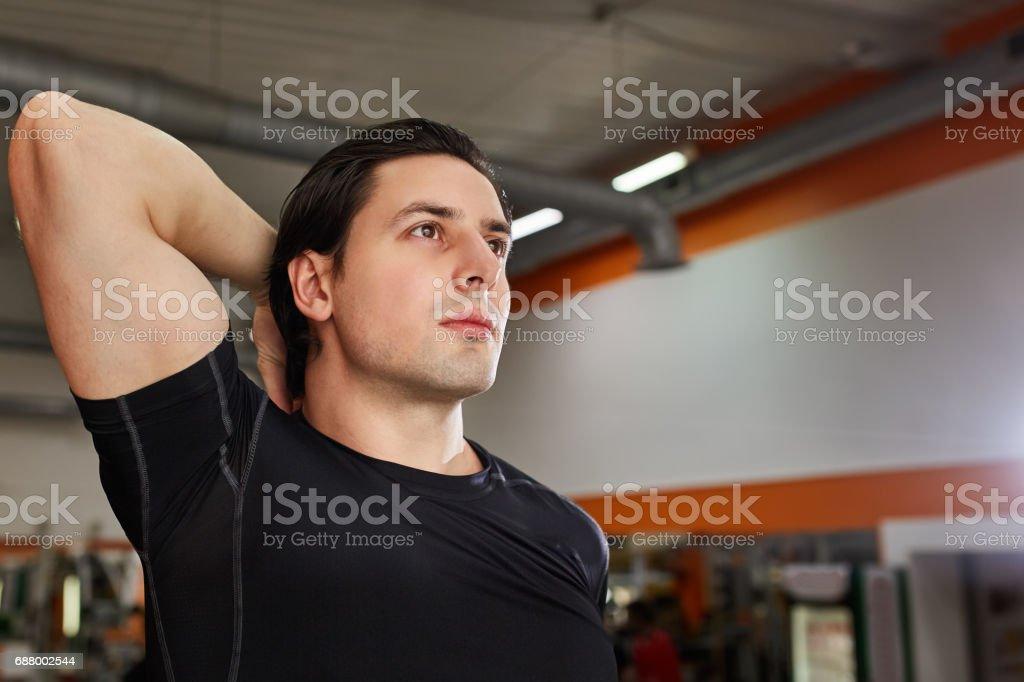 Portrait Of A Athlete Man Measuring His muscles In The Gym - foto de acervo