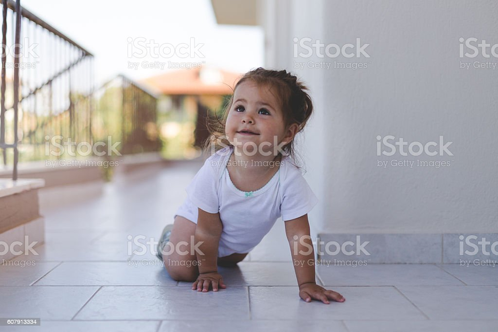 portrait of a baby girl on a terrace hallway stock photo