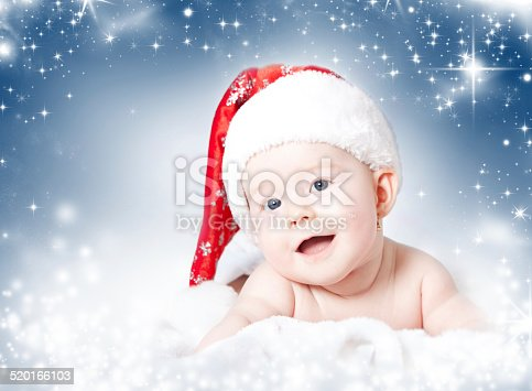 istock Portrait of a baby girl with Santa hat 520166103