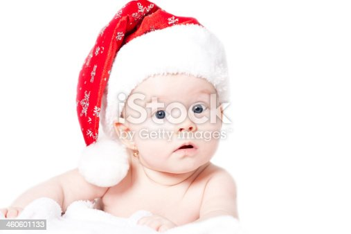 istock Portrait of a baby with Santa hat isolated on white 460601133