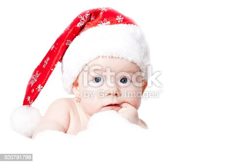 istock Portrait of a baby with Santa hat isolated on white 520791799