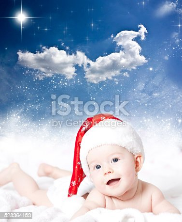istock Portrait of a baby with Santa hat 528364153
