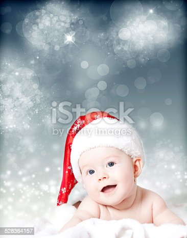 istock Portrait of a baby with Santa hat 528364157