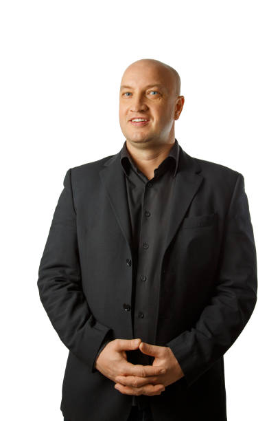 Portrait of a bald man in a black shirt and jacket on a white background, businessman stock photo