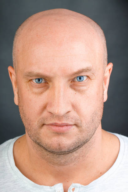 Portrait of a bald man with blue eyes close up stock photo