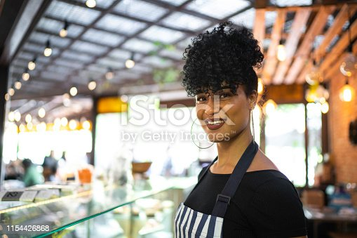 Portrait of a barista in a cafeteria