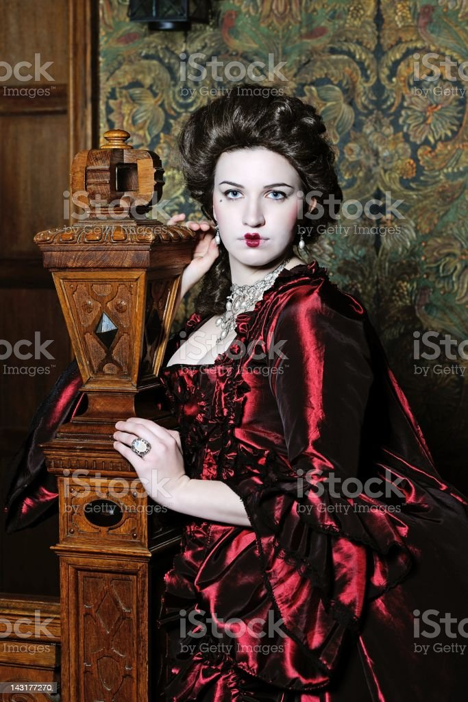 Portrait of a Baroque Lady before old Wall  Beautiful Dress royalty-free stock photo