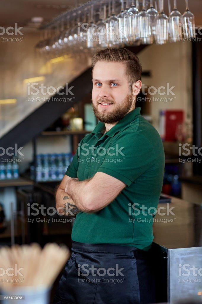 Portrait of a bartender barista waiter at the workplace in bar stock photo