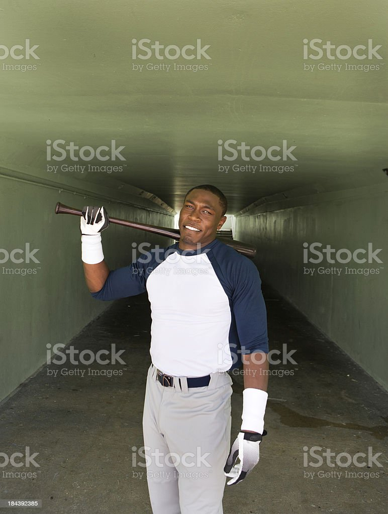 Portrait of a baseball player holding his bat stock photo