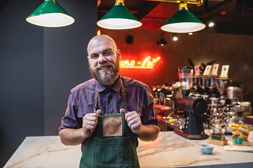 Portrait of a bearded barista
