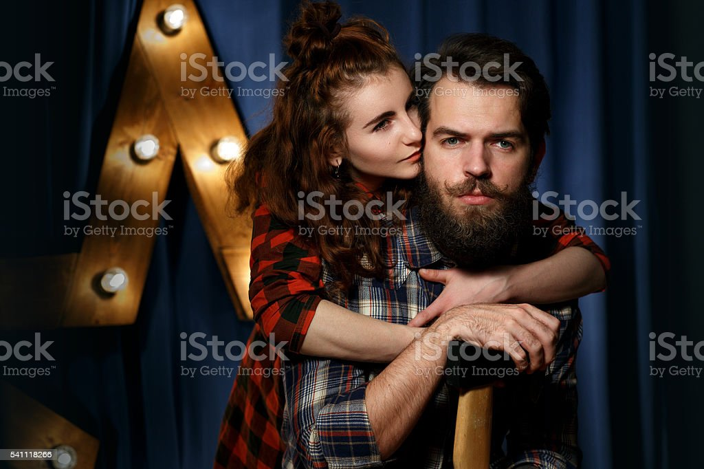 Portrait of a bearded, brutal guy and beautiful girl – Foto