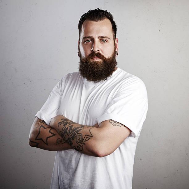 porträt des bärtigen mannes - tatto vorlagen stock-fotos und bilder