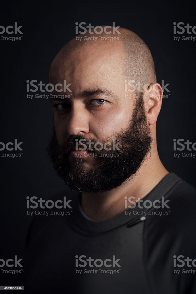 Portrait of a bearded man, stern staring at the camera stock photo