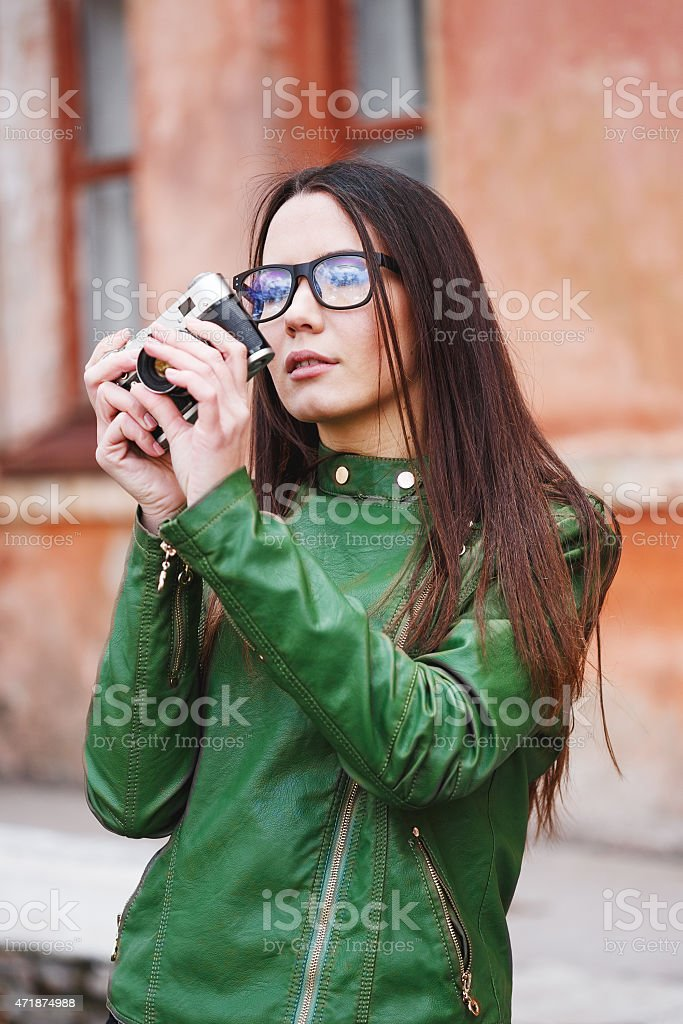 Portrait of a beautiful adult sensual woman with retro camera. stock photo