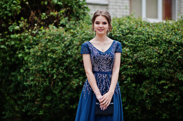 portrait of a beautiful and gentle girl in elegant gown posing outdoor. - prom stock photos and pictures