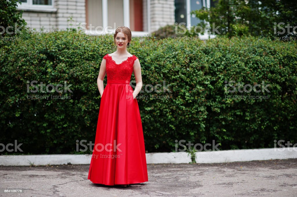 Portrait of a beautiful and gentle girl in elegant gown posing outdoor. royalty-free stock photo