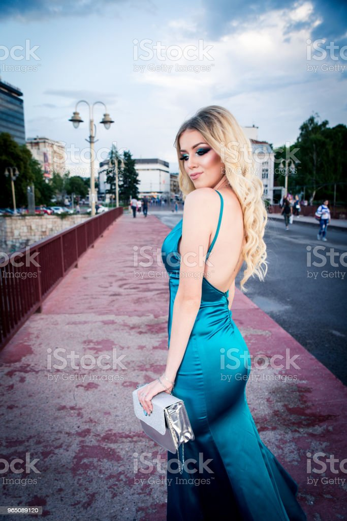 Portrait of a beautiful and gentle girl in elegant gown posing outdoor zbiór zdjęć royalty-free