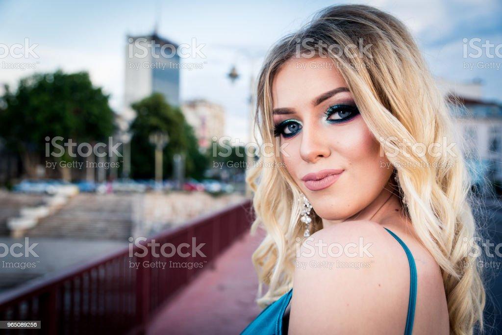 Portrait of a beautiful and gentle girl in elegant gown posing outdoor zbiór zdjęć royalty-free