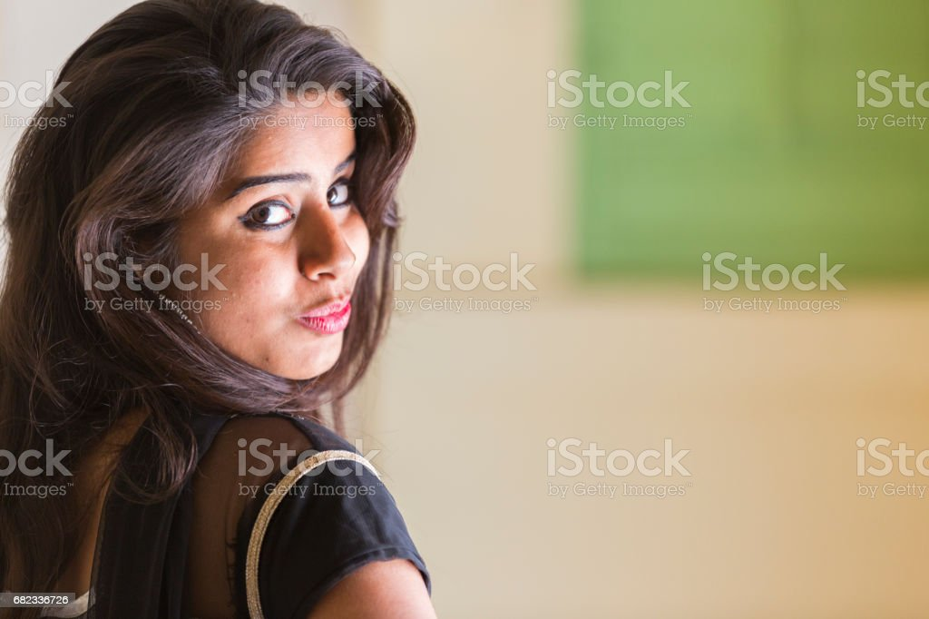 Portrait of a beautiful and happy Indian woman wearing traditional clothes. zbiór zdjęć royalty-free