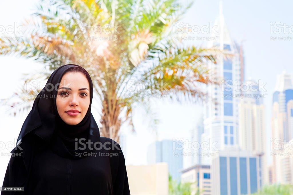 Portrait of a Beautiful Arabian Woman smiling in Dubai. stock photo