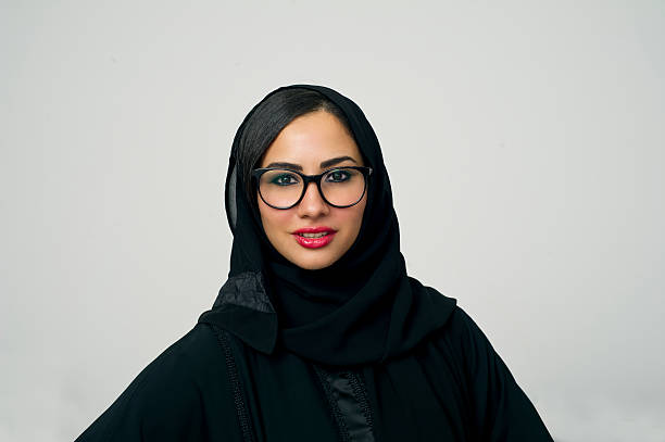 portrait of a beautiful arabian woman wearing hijab - saudi woman stock photos and pictures