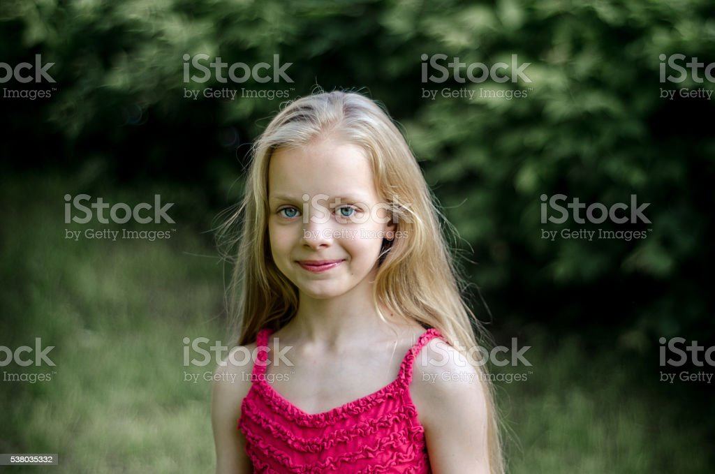 Portrait of a beautiful blonde little girl with long hair – Foto