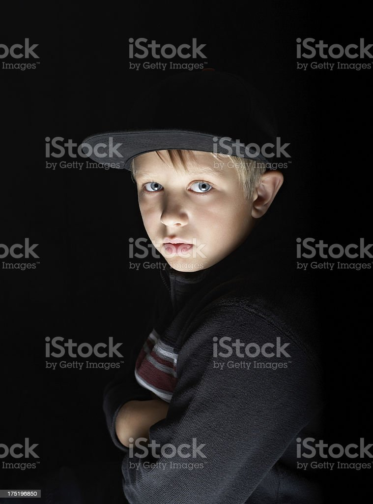 Portrait of a beautiful boy isolated on black background royalty-free stock photo