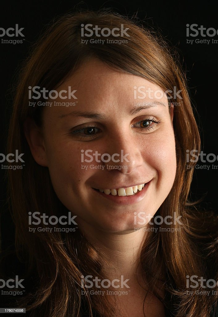 Portrait of a Beautiful Brunette on Black Background stock photo