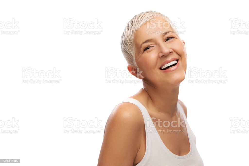 Portrait of a beautiful elderly woman, smiling, isolated on white background stock photo
