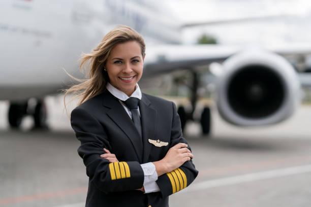 Portrait of a beautiful female pilot stock photo