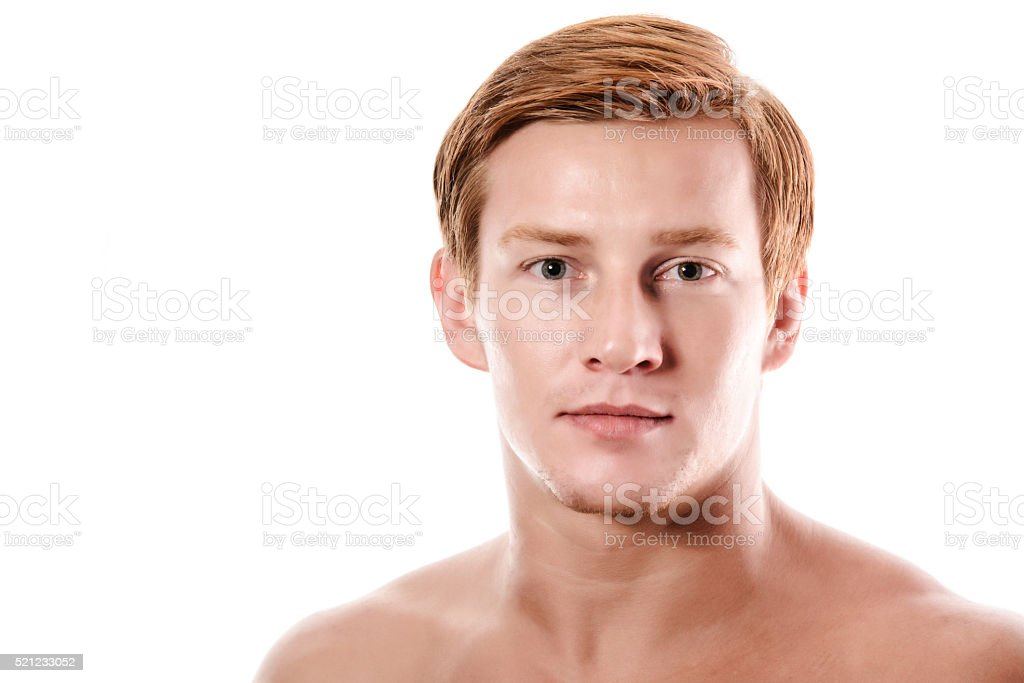 Portrait of a beautiful friendly young blond man stock photo